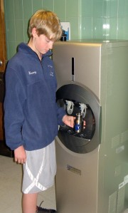students refilling their reusable water bottles